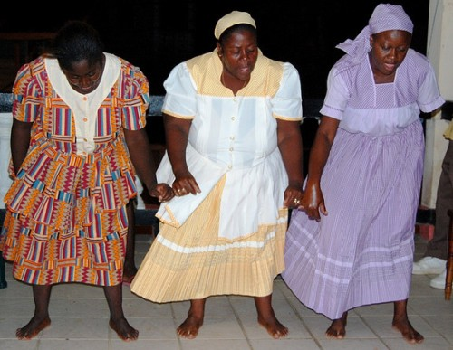 Traditional Garifuna dancers in Dangriga, Belize [Image by Rick Goldman, via Wikimedia Commons]