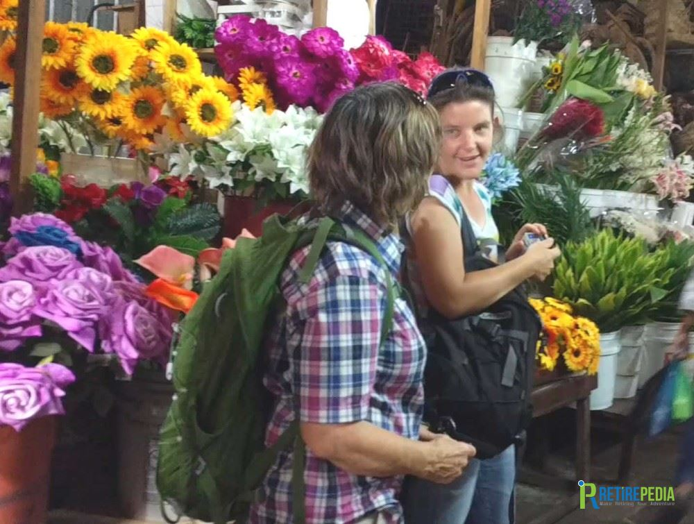 Real flowers and those made of fabric add to the colorful setting at the Mercado Roberto Huembes.