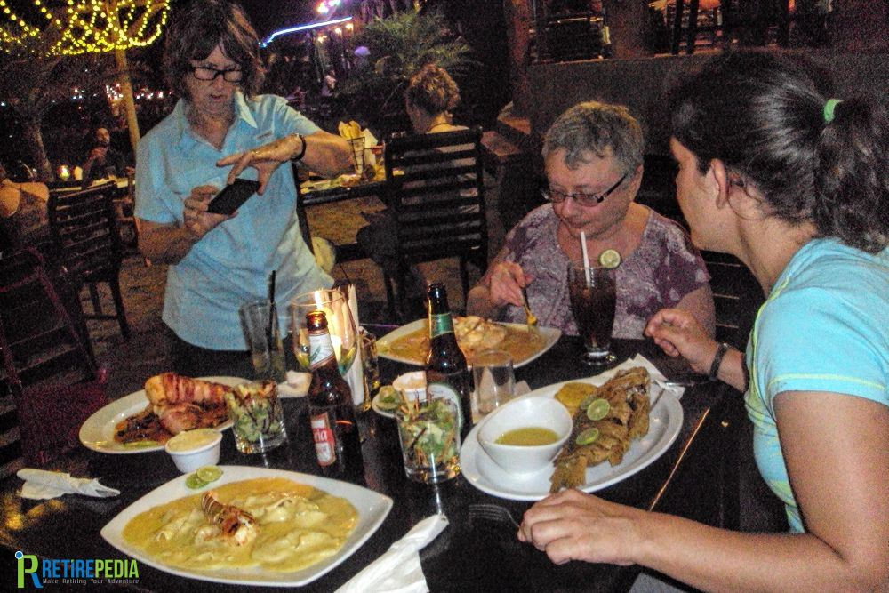 """Enjoying a delicious dinner at """"El Timón,"""" one of the many beach restaurants in San Juan del Sur. Fish, lobster, chicken, beef or pasta... the choice is yours!"""
