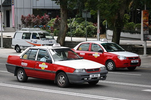 "Taxis in Kuala Lumpur with the ""Bermeter"" sign on top [Photo by Ilya Plekhanov (Own work), via Wikimedia Commons]"