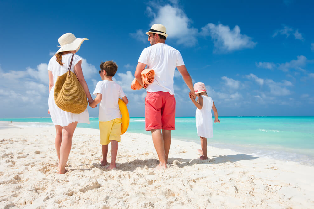 A picture of a family on a beach.