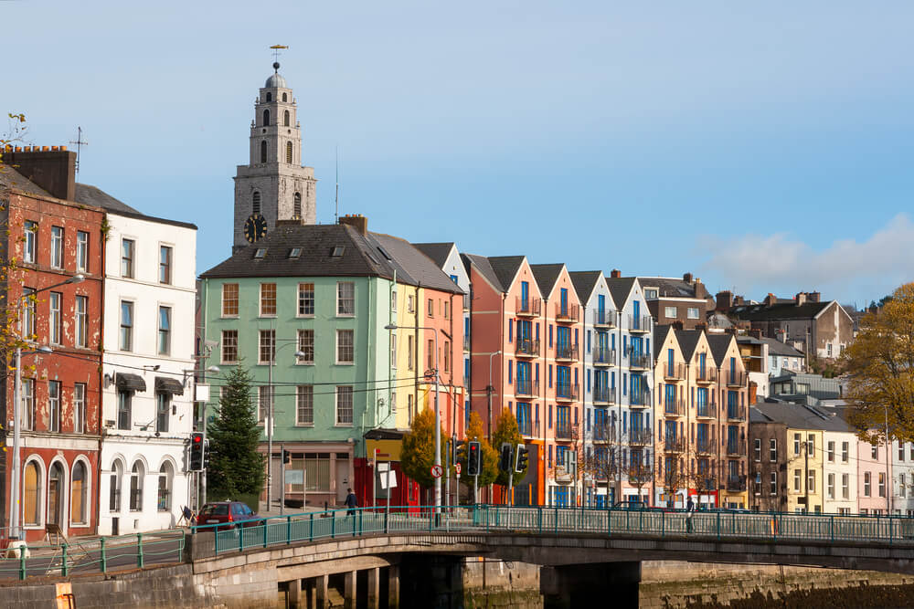 A picture of several multi-story buildings along a road in Cork, Ireland.