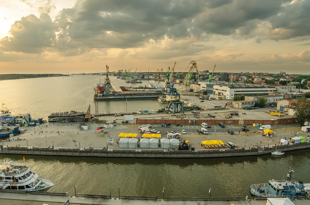 An arial view of Klaipeda, Lithuania. You can see boats docking and cranes loading boats.