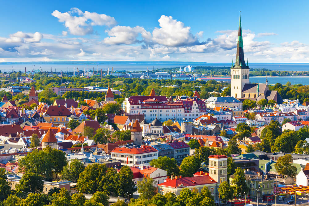 An arial view of Tallinn, Estonia. You can see the city and the water in the background.