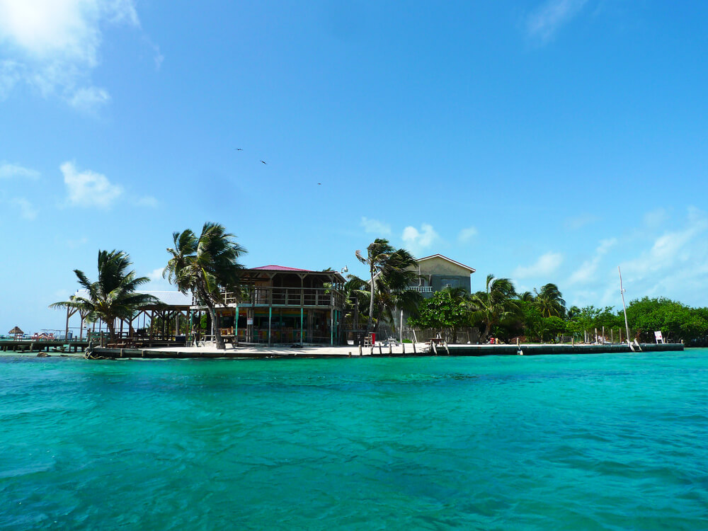 A picture of a bar in Caye Caulker (Belize). The picture is from the ocean looking in towards the beach.