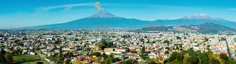 A panoramic picture of Puebla, Mexico showing all the houses, buildings, and city.
