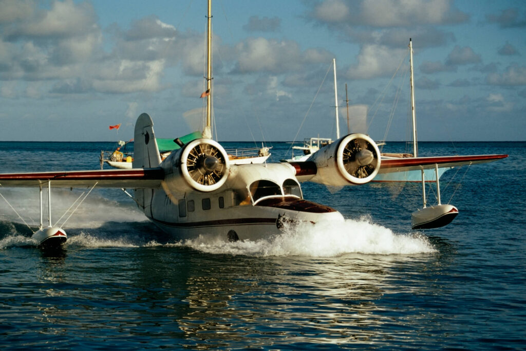An image showing a twin propellor sea plane landing on the ocean in St Croix, U.S. Virgin Islands