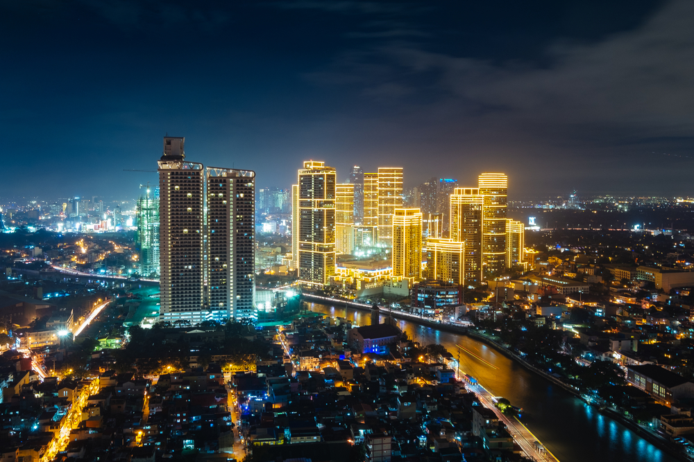 A picture of the city of Manila, Philippines at night. Aerial view.