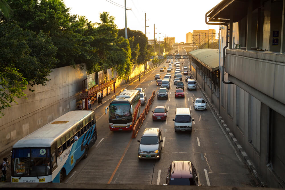 A picture of vehicles driving down a street in Manilla, Philippines