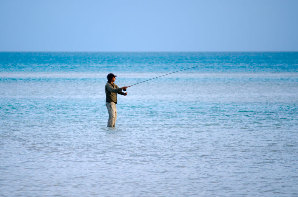 A man saltwater fly fishing.