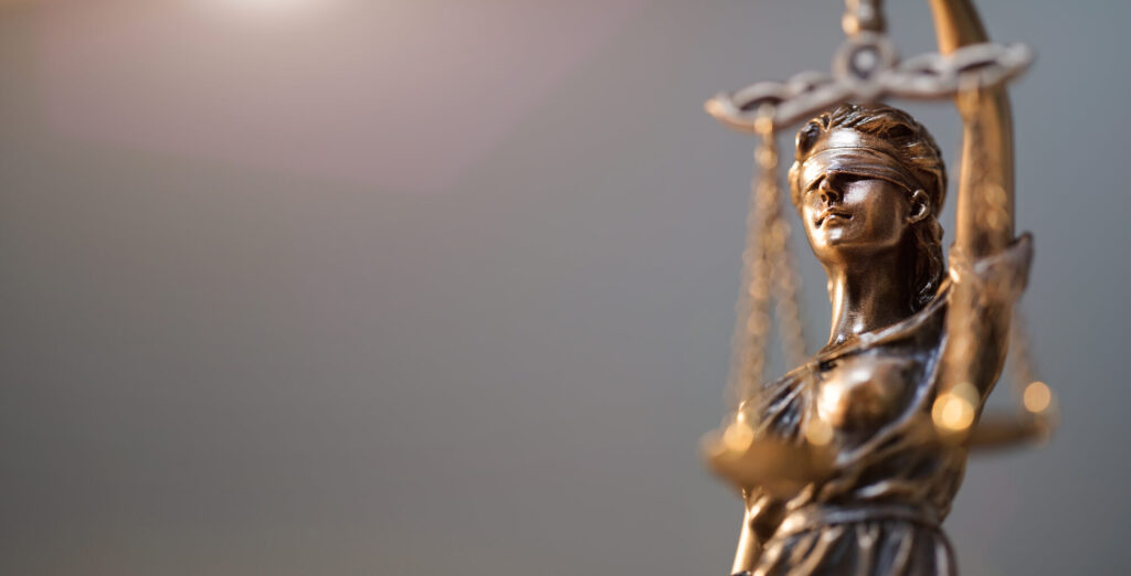 A bronze statue of lady justice symbolizing the governments of Costa Rica and Panama