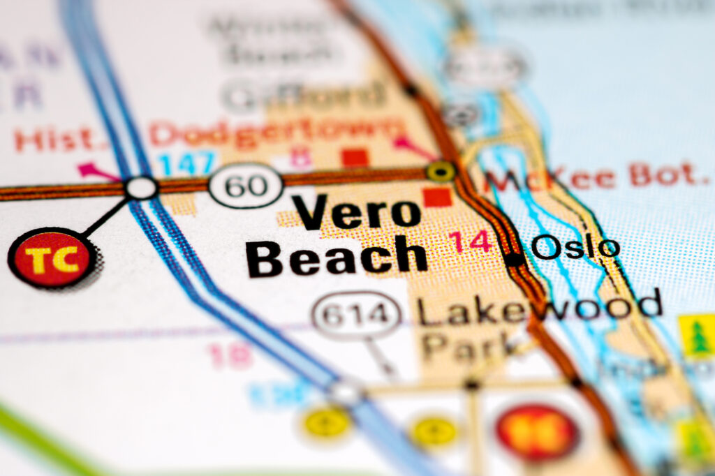 A close up image of a road map with Vero Beach Florida in focus