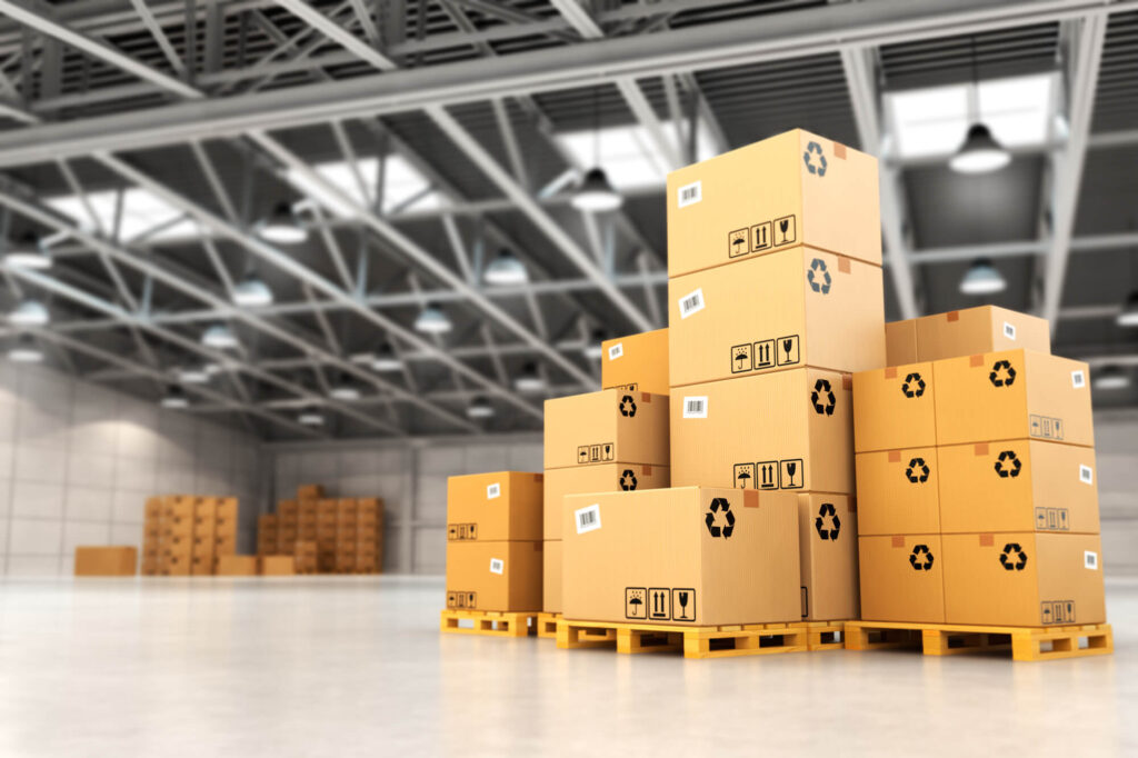 A high resolution image of a warehouse with a number of boxes on a pallet, representing a delivery service