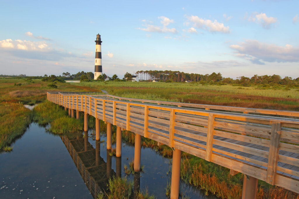 A picture of a qalkway over a marsh to the Bodie Island lighthouse