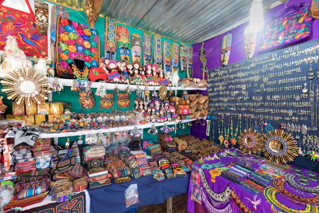 An image of a street stall in Boquete, Panama. It features a large display of colorful costume jewelery and handicrafts