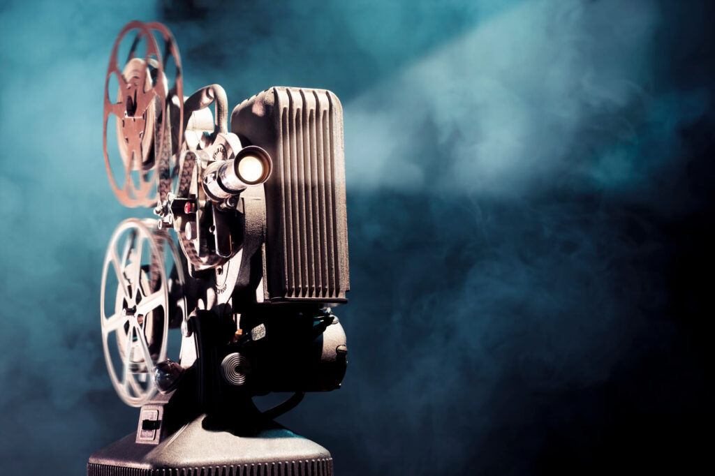 An image of an old philm projector with a black background