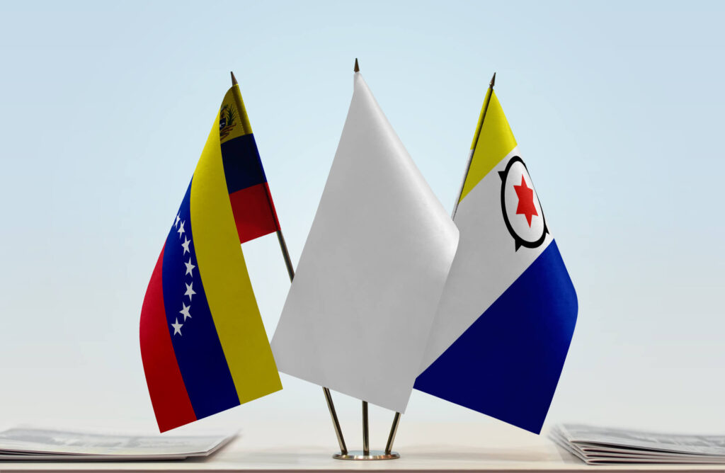 An image showing the flags of Venezula and Bonaire. Between the two flags is a white flag
