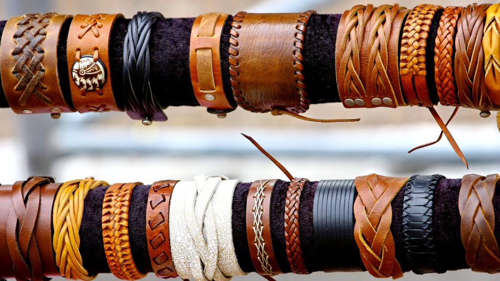 A photo of a dozen leather bracelets made in Mexico