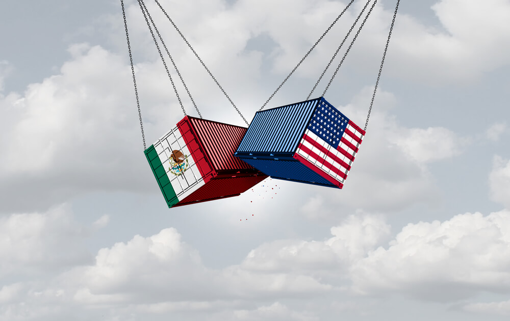 An illustration show two cargo containers suspended in the air. On one container is a U.S. flag and on the other is the Mexican flag. It represents trade between the two countries