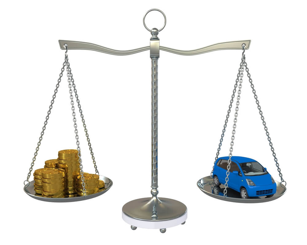 An illustration showing a set of scales with a pile of coins on one side and a blue car on the other. It rerpresents price comparisons for used cars