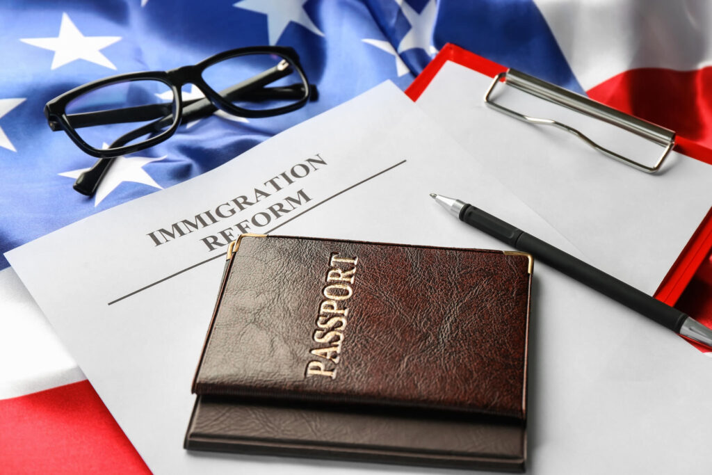 An image of a U.S. passport sitting on top of a document labeled immigration reform