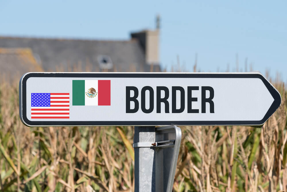 An image of a small sign that shows the flags of the United States and Mexico, along with the word Border. It points to the US and Mexico border