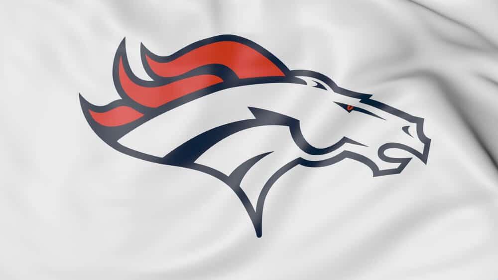 A close-up photo of a flag with the Denver Broncos NFL American football team logo