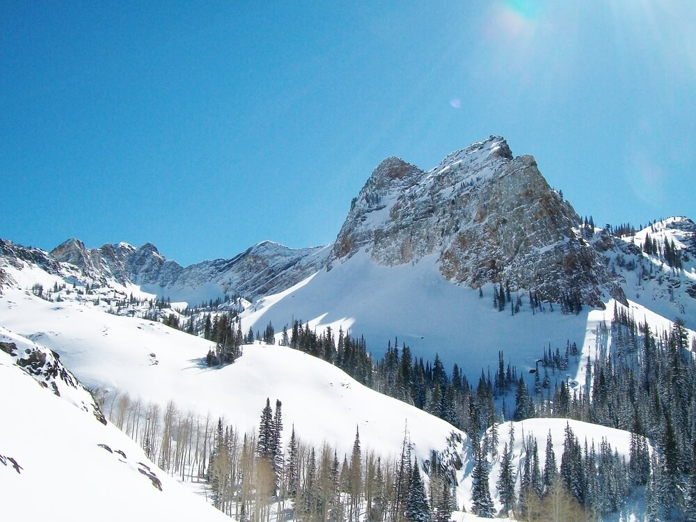 A photo of Sundial Peak in Utah. It is a 7,590-foot elevation white Navajo Sandstone summit which is a popular location for hiking and skiiing