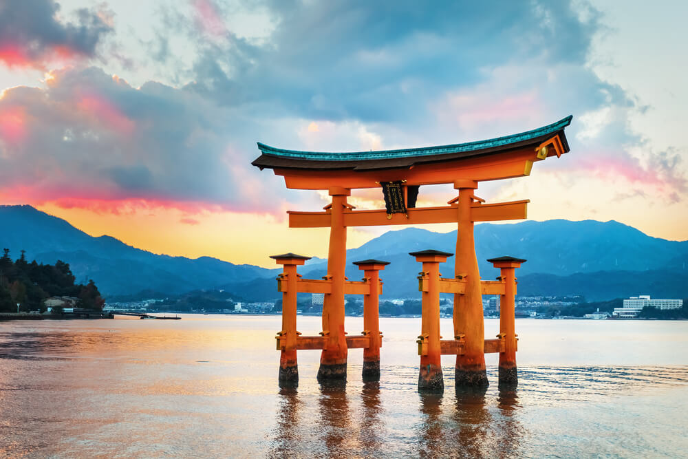 A photo of the Great floating gate (O-Torii) in Miyajima, Hiroshima. It shows a partially submerged traditional Japanese gate