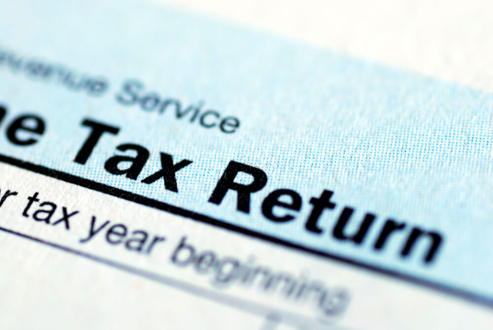 A close up photograph of a document with the words Tax Return printed on it