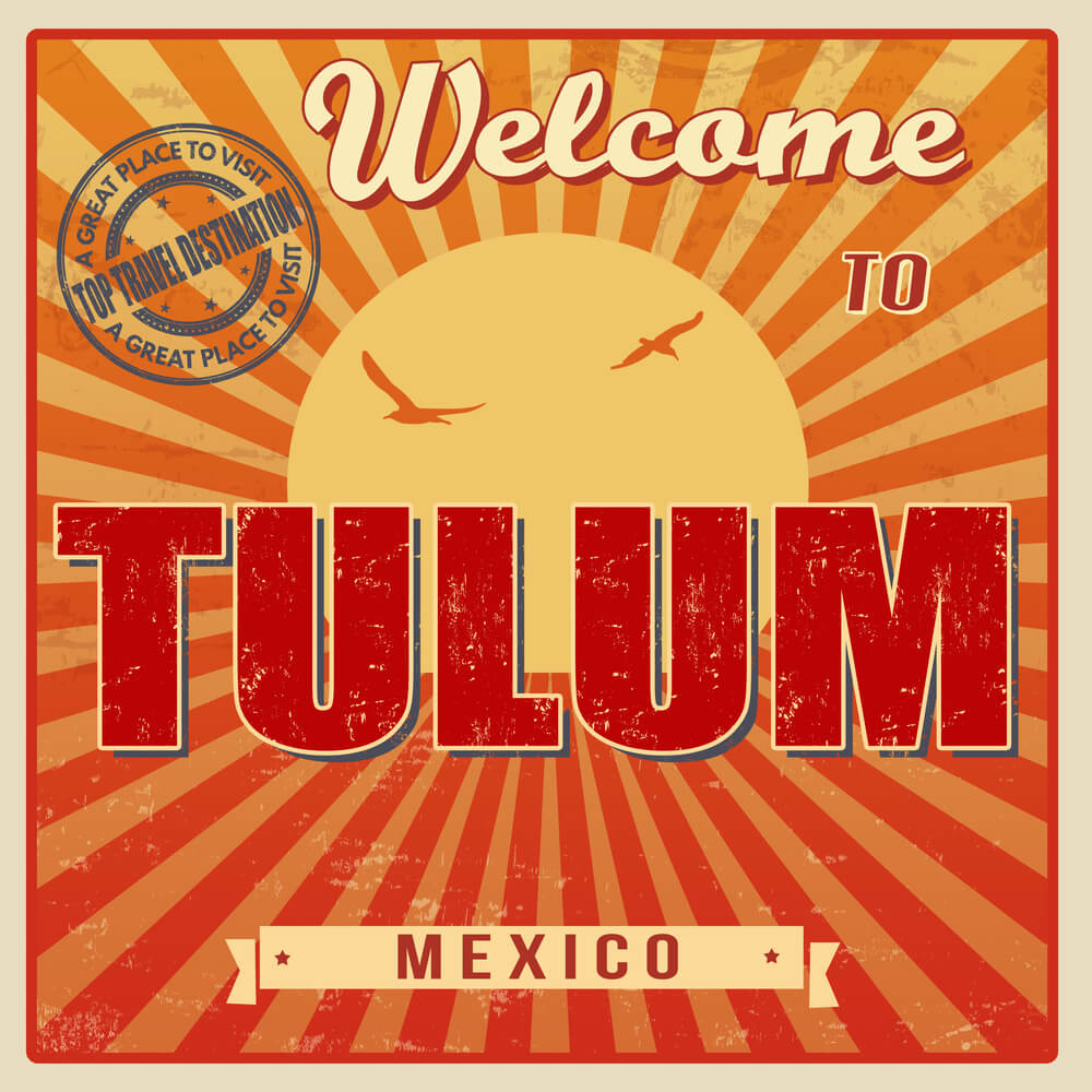 A colorful poster that says Welcome to Tulum. The poster is design with bold fonts with orange and yellow beams shooting out from a sun in the background