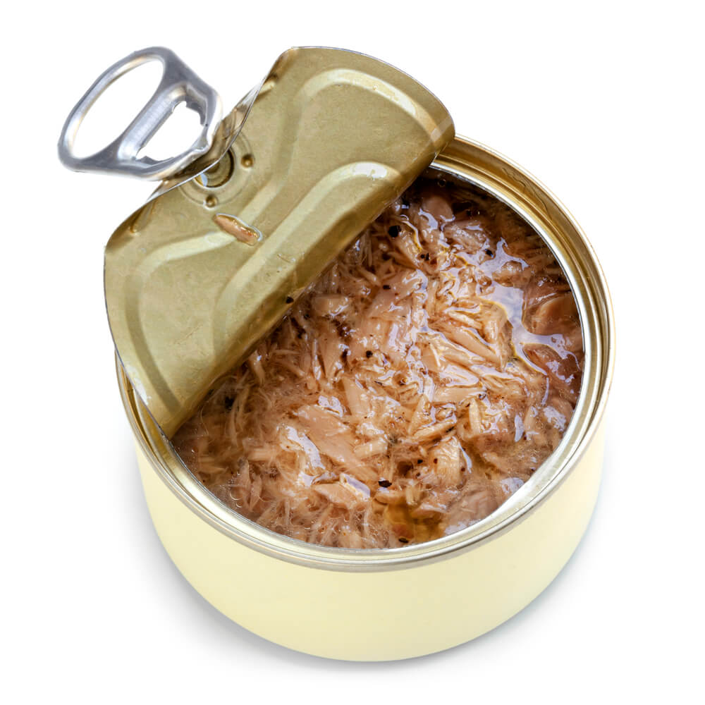A picture of an open can of tuna on a white brackground