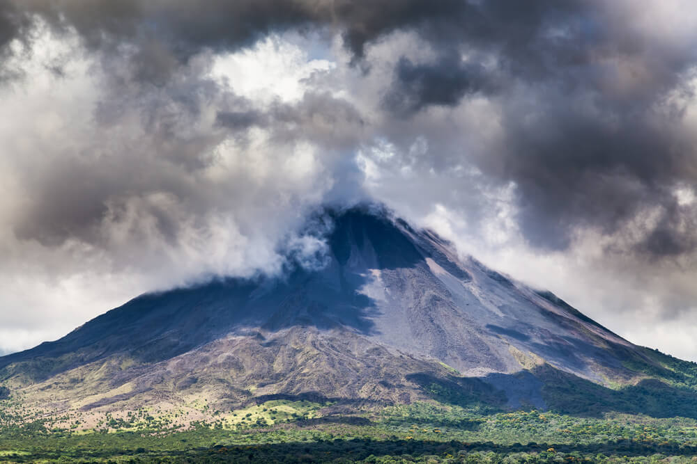 An image of dark storm clouds rolling across a large mountain in Costa Rica