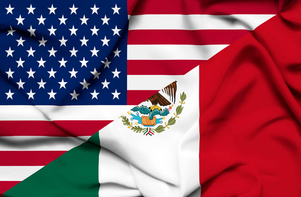 An image of the American and Mexican flags side by side representing the close relationship between the two countries