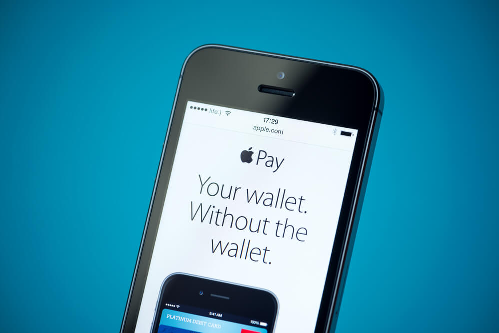 An image of a mobile phone showing an ad for Apple Pay. The ad features an Apple Pay slogan, Your Wallet Without The Wallet