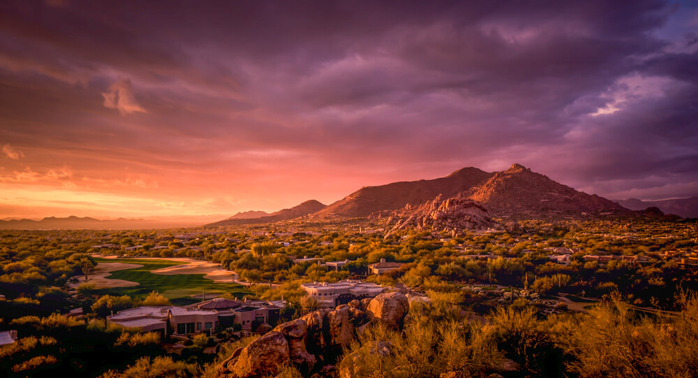 A beautiful Arizona sunset with gold course in the front and mountain in the back