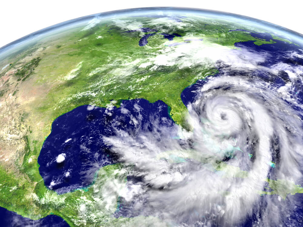 A satellite image showing the white clouds of a large hurricane heading towards the east coast of america