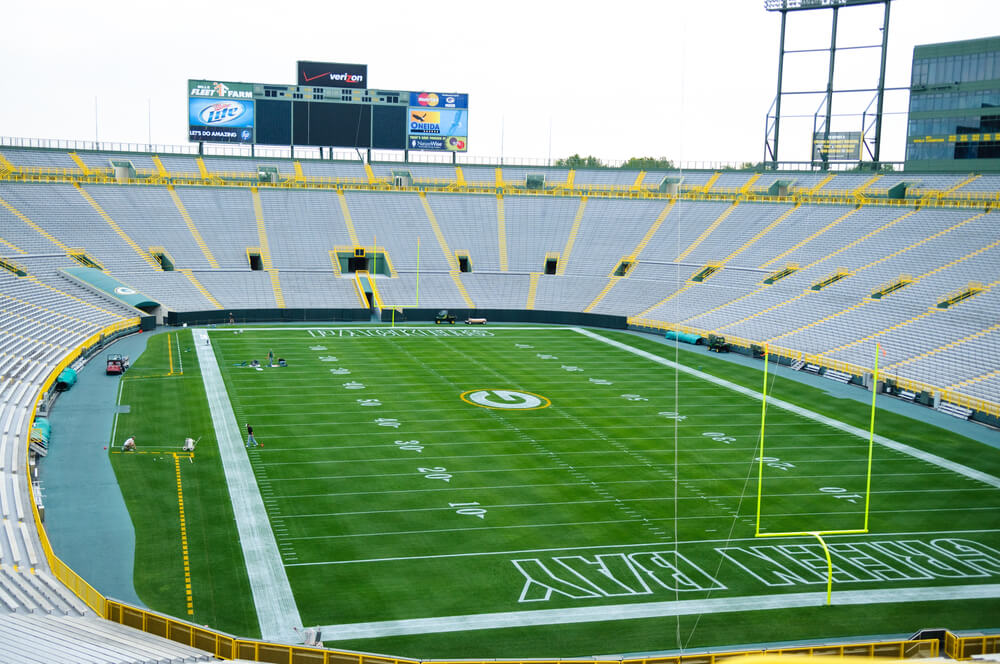A photo of an empty Lambeau Field with the Green Bay Packers football team plays.