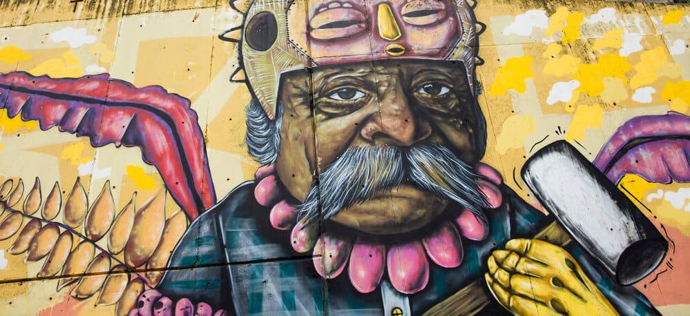 An abstract cartoon street painting of a man holding a sledgehammer