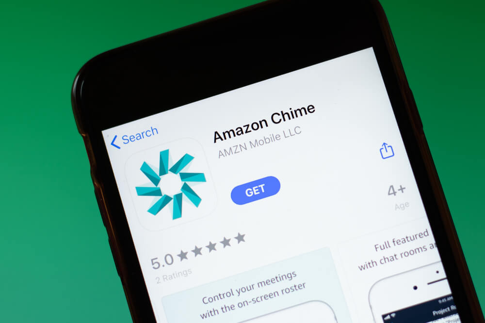 A cell phone shows an image of an App store where someone can download the Amazon Chime app.