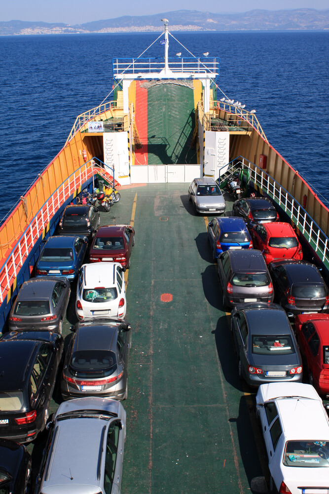 A photo of a ferry transporting several cars