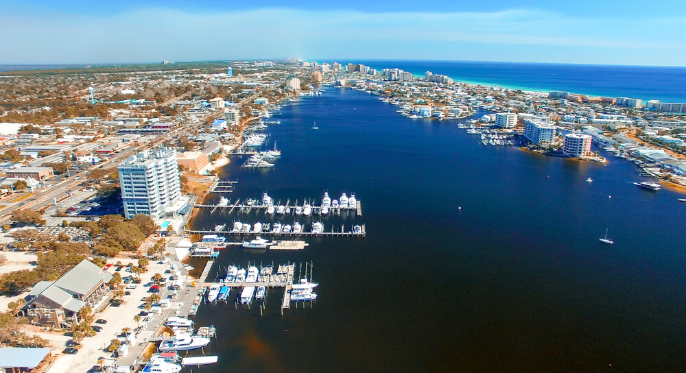 An aerial photo of Destin showing a lot of buildings and surrounded by a lot of water